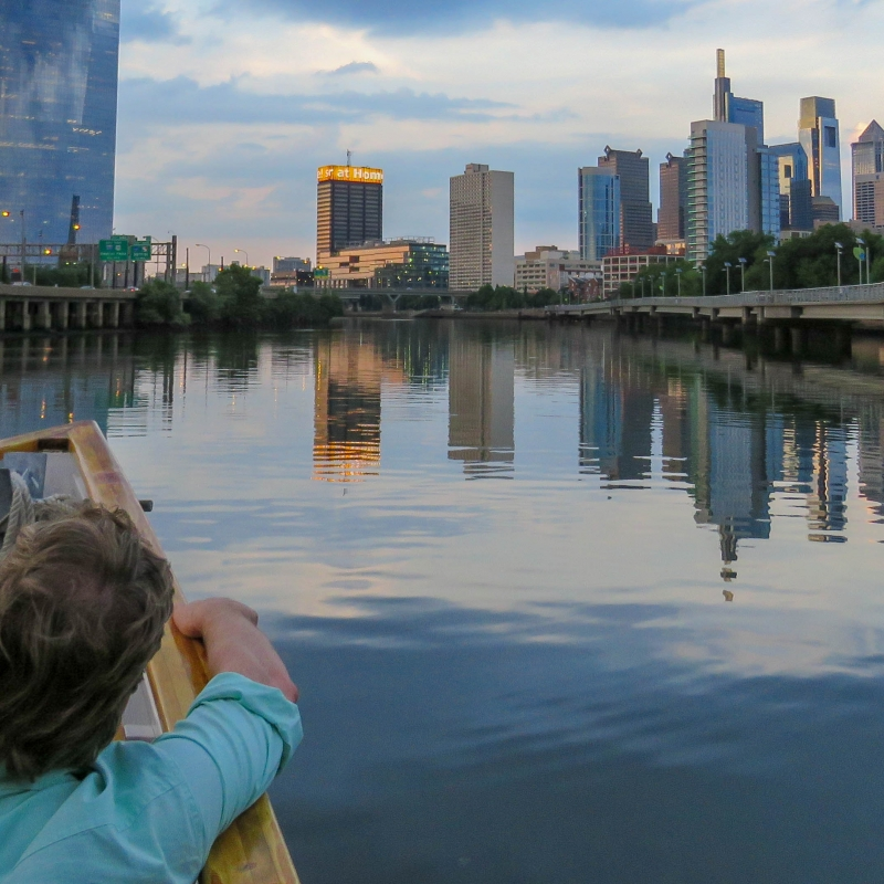 A couple takes in the Philadelphia Skyline on a Schuylkill Banks Riverboat Tour