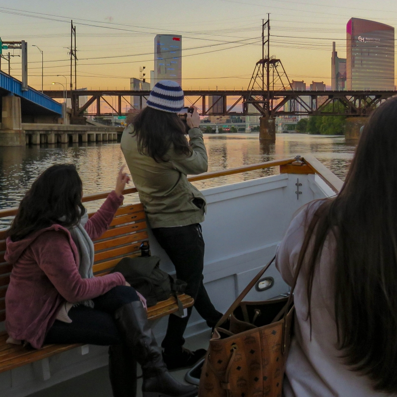 Women enjoy the view on a Schuylkill Banks Riverboat Tour